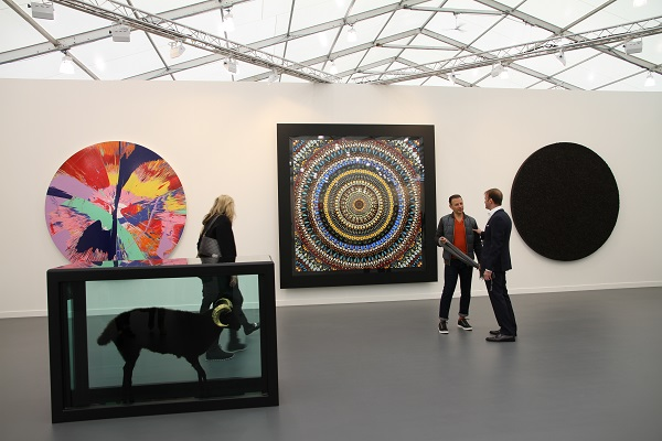 Visitors to Frieze New York at Gagosian Gallery's Damien Hirst booth2.jpg